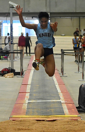 Enid's D' Dani Levy competes in the long jump during an indoor track and field meet at the Chisholm Trail Expo Center. (Billy Hefton / Enid News & Eagle)
