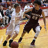 Ringwood's Jacob Briggs drives to the basket against Garber's Daegan Vandiver in a regional tournament game Thursday February 15, 2018 at Ringwood High School. (Billy Hefton / Enid News & Eagle)