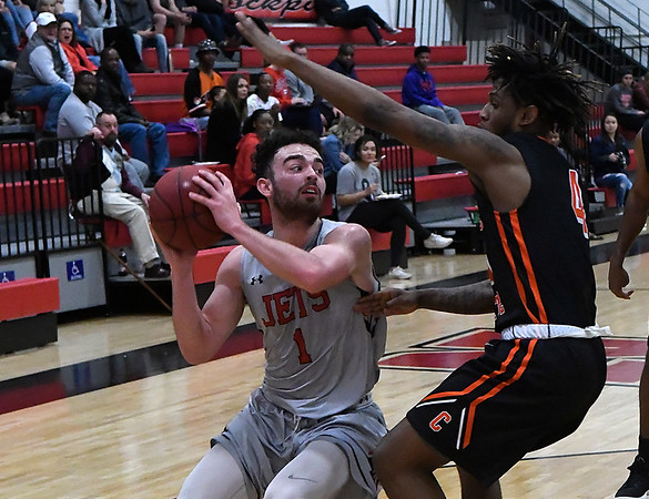 NOC Enid's Lense Ramey looks for an opening against Connors State's Ra'Shawn Langston Monday February 19, 2018 at the NOC Mabee Center. (Billy Hefton / Enid News & Eagle)