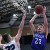 Hooker's Tate Cathcart shoots over Hennessey's Dalton Vinson during the Downtown Basketball Festival Saturday February 3, 2018 at the Central National Bank Center. (Billy Hefton / Enid News & Eagle)