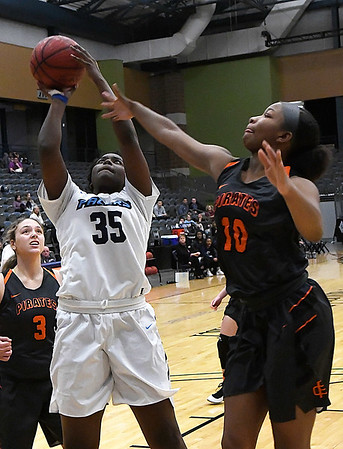 Enid's Niesha Fuston scores against Putnam City's Tonijah Fortune Tuesday February 6, 2018 at the Central National bank Center. (Billy Hefton / Enid News & Eagle)