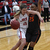 NOC Enid's McKenna Pulley drives towards the basket against Connors State's Tierra Jones Monday February 19, 2018 at the NOC Mabee Center. (Billy Hefton / Enid News & Eagle)