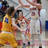 Chisholm's Danae Stidam shoots over Newkirk's Kori Walters during the regional playoffs Friday February 23, 2018 at Chisholm High School. (Billy Hefton / Enid News & Eagle)