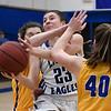 Hennessey's Hali Tuell tries to drive to the basket against Newkirk's LeeAnn Cooper and Rylee Lvis during the district tournament Friday February 16, 2018 at Hennessey High School. (Billy Hefton / Enid News & Eagle)