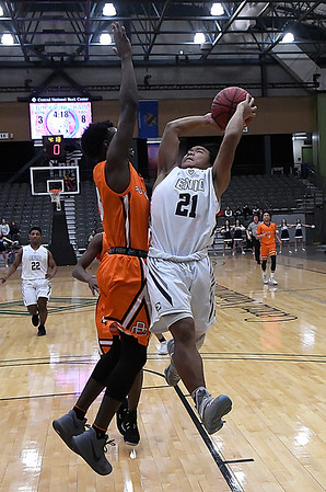 Enid's Jadon Dimarucut goes to the basket against Putnam City's Kelvin Dickerson Tuesday February 6, 2018 at the Central National bank Center. (Billy Hefton / Enid News & Eagle)