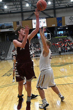 Garber's Jake Beebe puts up a shot against Laverne's Owen Linville during an elimination game of the area playoffs Friday February 23, 2018 at the Central National Bank Center in Enid. (Billy Hefton / Enid News & Eagle)