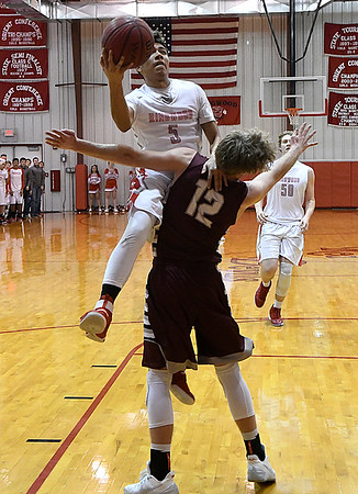 Ringwood's Carlos Aguilar goes to the basket against Garber's Dayne Fuxa in a regional tournament game Thursday February 15, 2018 at Ringwood High School. (Billy Hefton / Enid News & Eagle)