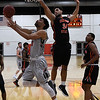 NOC Enid's Tony Hall goes under Connors State's Bishop Coulter for a shot Monday February 19, 2018 at the NOC Mabee Center. (Billy Hefton / Enid News & Eagle)