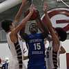 Covington-Douglas' Glorie Houmba goes up for a shot between Garber's Rodney Phelps and Daegan Vandiver Friday February 2, 2018 at Garber High School. (Billy Hefton / Enid News & Eagle)