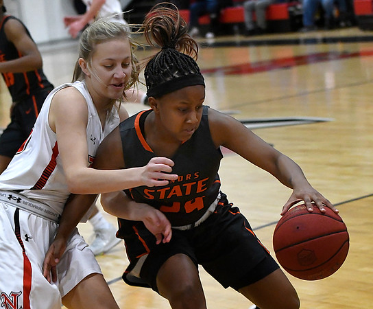 NOC Enid's Macie Jo Pierce pressures Connors State's Saide Carter Monday February 19, 2018 at the NOC Mabee Center. (Billy Hefton / Enid News & Eagle)