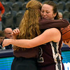 Garber head coach, Jamie Davis, hugs Macy Swart after Swart made a three point basket as time expired to give the Lady Wolverines a 46-45 win over Texhoma in an elimination game of the area playoffs Friday February 23, 2018 at the Central National Bank Center in Enid. (Billy Hefton / Enid News & Eagle)