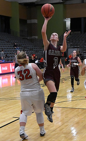 Garber's Kathryn Plunkett shoots against Texhoma's Macy Cossell during the Lady Wolverines a 46-45 win over Texhoma in an elimination game of the area playoffs Friday February 23, 2018 at the Central National Bank Center in Enid. (Billy Hefton / Enid News & Eagle)