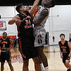 NOC Enid's Bryshon Bryant goes up against Connors State's Bishop Coulter for a shot Monday February 19, 2018 at the NOC Mabee Center. (Billy Hefton / Enid News & Eagle)