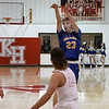 Drummond's Garrett Pool shoots over Kremlin-Hillsdale's Draden Stallings during the first game of the district playoffs Friday February 9, 2018 at Kremlin-Hillsdale High School. (Billy Hefton / Enid News & Eagle)