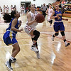Kremlin-Hillsdale's Daylan Dulinsky drives to the basket against Drummond's Alexis Peeper during the first game of the district playoffs Friday February 9, 2018 at Kremlin-Hillsdale High School. (Billy Hefton / Enid News & Eagle)