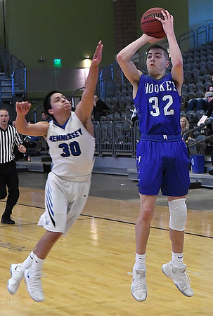 Hennessey's Carlos Rojo tries to defend the three point shot Hooker's Jared Kerr during the Downtown Basketball Festival Saturday February 3, 2018 at the Central National Bank Center. (Billy Hefton / Enid News & Eagle)