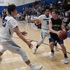 Hennessey's Brandon Ramirez and Hugo Rodriguez pressure Newkirk's Garrett Stone in the district tournament Friday February 16, 2018 at Hennessey High School. (Billy Hefton / Enid News & Eagle)