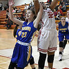 Kremlin-Hillsdale's Mahayla Mitchell gets tangles with Drummond's Kaitlyn Wilson as she puts up a shot during the first game of the district playoffs Friday February 9, 2018 at Kremlin-Hillsdale High School. (Billy Hefton / Enid News & Eagle)