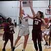 NOC Enid's Andi Pierce shoots over Redlands' Dawnell Vann Monday February 12, 2018 at the NOC Mabee Center. (Billy Hefton / Enid News & Eagle)