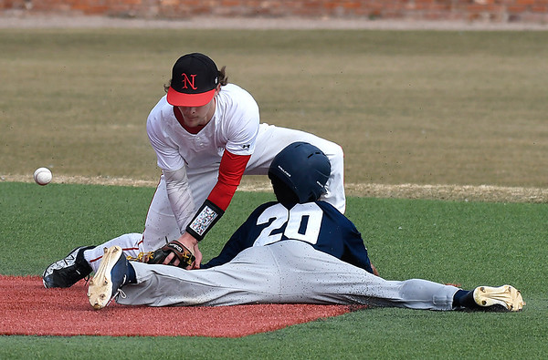 NOC Enid's D.J. Calvert bobbles the ball as Independence CC's Stweard Ojeda slides into second base Tuesday February 13, 2018 at David Allen memorial Ballpark. (Billy Hefton / Enid News & Eagle)