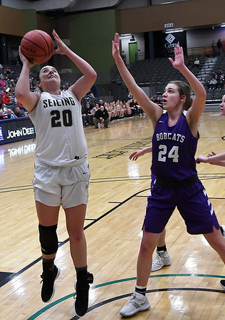 Seiling's Karly Gore puts up a shot in the lane against Hydro-Eakly's Rachel Barry during the class A area 1 championship game Friday Feb.22, 2019 at the Central National Bank Center. (Billy Hefton / Enid News & Eagle)