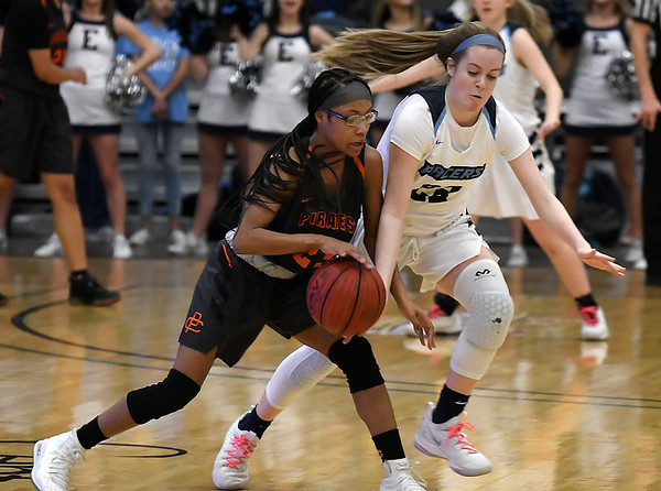Enid's Cayti Moeller tries to steal the ball from Putnam City's Daja Thomas Tuesday February 12, 2019 at the Central National Bank Center. (Billy Hefton / Enid News & Eagle)