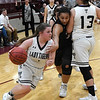 Timberlake's Caitlyn Fargo drives towards the basket as Samantha Phillips screens Lookeba-Sickles' Kelsi Cox during the regional tournament Thursday February 14, 2019 at Pioneer High School. (Billy Hefton / Enid News & Eagle)