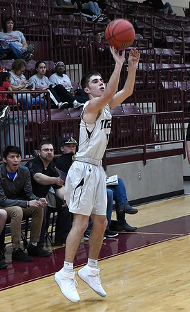 Timberlake's Preston Pierce shoots a three point shot against Lookeba-Sickles during the regional tournament Thursday February 14, 2019 at Pioneer High School. (Billy Hefton / Enid News & Eagle)