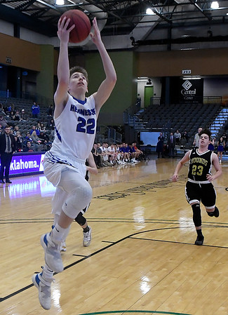 Hennessey's Wade Vinson scores a fastbreak basket against Mounds during the Enid Downtown Basketball Festival at the Central National Bank Center Saturday February 2, 2019. (BIlly Hefton / Enid News & Eagle)