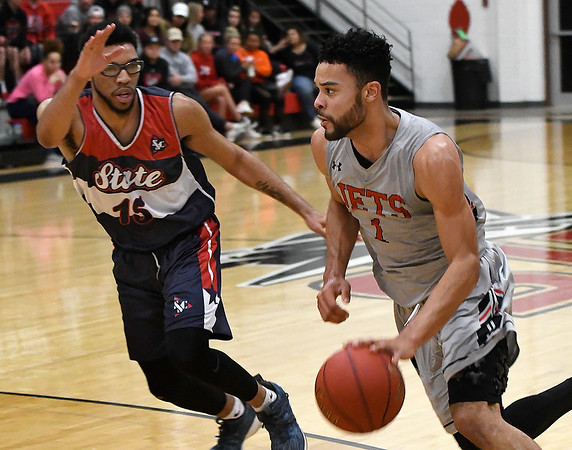 NOC Enid's Tony Hall drives towards the basket against Seminole State's Carlos Slaughter Monday February 11, 2019 at the NOC Mabee Center. (Billy Hefton / Enid News & Eagle)