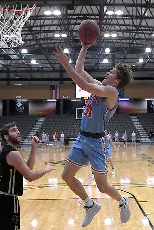 Chisholm's Gage Kuehn puts up a shot against Cashion during the Enid Downtown Basketball Festival February 1, 2019 at the Central National Bank Center. (Billy Hefton / Enid News & Eagle)