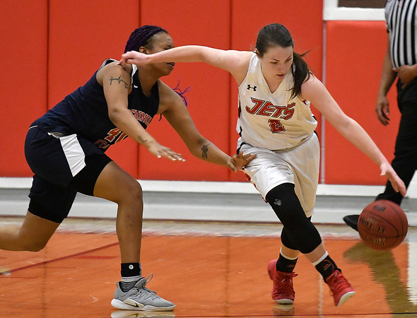 NOC Enid's Jacie Engler dribbles away from pressure by Seminole State's Maikayla Chambers Monday February 11, 2019 at the NOC Mabee Center. (Billy Hefton / Enid News & Eagle)