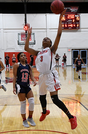 NOC Enid's Monique Tramble scores a basket against Seminole State Monday February 11, 2019 at the NOC Mabee Center. (Billy Hefton / Enid News & Eagle)