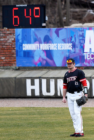 NOC Enid's Tanner Neely stands in righfield between pitches against Northeast Nebraska as the temperature reads 64 degrees for the first game of the season. Saturday February 2, 2019 at David Allen Memorial Ballpark. NOC Enid host Northeast Nebraska again today at David Allen Memorial Ballpark beginning at noon. (Billy Hefton / Enid News & Eagle)