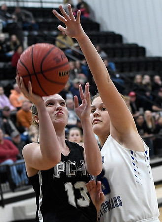 Pond Creek-Hunter's Lauren Tefft puts up a shot against Woodland's Raychel Bennett during the opening game of the district playoffs Friday February 8, 2019 at Pond Creek-Hunter High School. (Billy Hefton / Enid News & Eagle)