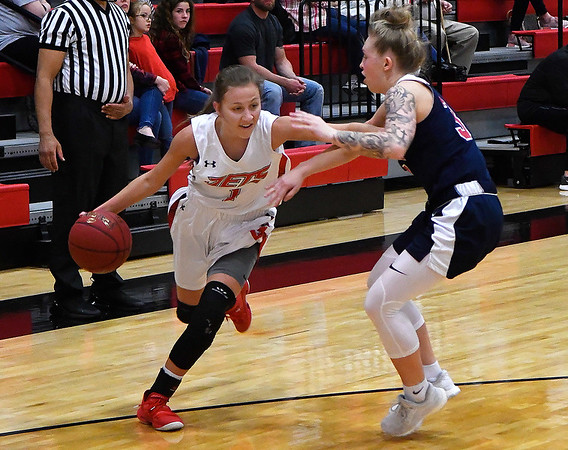 NOC Enid's Macie Jo Pierce drives towards teh basket against Seminole State's Kinsey Callen Monday February 11, 2019 at the NOC Mabee Center. (Billy Hefton / Enid News & Eagle)