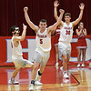 Chisholm's Kolten Childers, Alex Angleton and Gage Kuehn celebrate a 53-50 overtime win over Prague in a class 3A regional tournament Thursday Feb. 21, 2019 at Chisholm High School. (Billy Hefton / Enid News & Eagle)