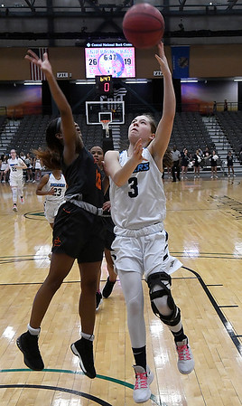 Enid's Ashley Handing shoots over Putnam City's Tonijah Fortune Tuesday February 12, 2019 at the Central National Bank Center. (Billy Hefton / Enid News & Eagle)