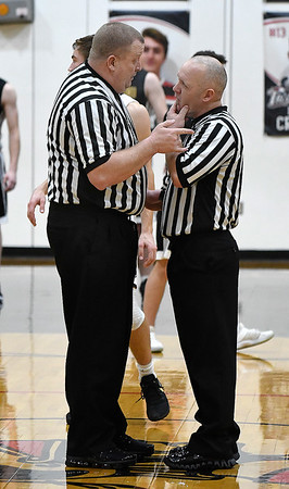 Referees meet at center court during an elimination game between Drummond and Oklahoma Bible Academy in the regional tournament Thursday February 14, 2019 at Oklahoma Bible Academy. (Billy Hefton / Enid News & Eagle)