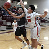 Pioneer's Kevin Noel goes up for a shot aginat Pawnee's Jaden Leading Fox during an elimination game in a class 2A regional tournament Saturday Feb. 23, 2019 at Pioneer High School. (Billy Hefton / Enid News & Eagle)