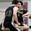 Drummond's Garrett DeHass and Presley Moore celebrate a 68-66 win over Oklahoma Bible Academy Thursday February 14, 2019 in an elimination game in the regional tournament at Oklahoma Bible Academy. (Billy Hefton / Enid News & Eagle)
