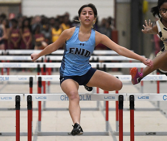 Enid's Bethany Gonzales runs the 55-meter hurdles Friday February 1, 2019 at the Chisholm Trail Expo Center. (Billy Hefton / Enid News & Eagle)