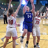 Waukomis' Brynlee Cue puts up a shot between Shattuck's Samantha Cummings and Jena Bay during an elimination game in the class A area tournament Thursday Feb. 21, 2019 at the Central National Bank Center. (Billy Hefton / Enid News & Eagle)