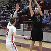 Pioneer's Payton Wingo shoots over Pawnee's Joseph Gordon during an elimination game in a class 2A regional tournament Saturday Feb. 23, 2019 at Pioneer High School. (Billy Hefton / Enid News & Eagle)