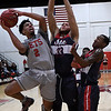 NOC Enid's Questyn Luckey puts up a shot against Seminole State's Benjamin Jenkins Monday February 11, 2019 at the NOC Mabee Center. (Billy Hefton / Enid News & Eagle)