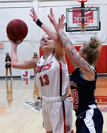 NOC Enid's Kaylee Hurst puts up a shot against Seminole State's Kinsey Callen Monday February 11, 2019 at the NOC Mabee Center. (Billy Hefton / Enid News & Eagle)