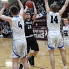 Timberlake's Cade Redding gets off a shot between Lomega's Noah Snowden Karson Glazier during an elimination game in a class B regional tournament Friday Feb. 15, 2019 at Pioneer High School. (Billy Hefton / Enid News & Eagle)