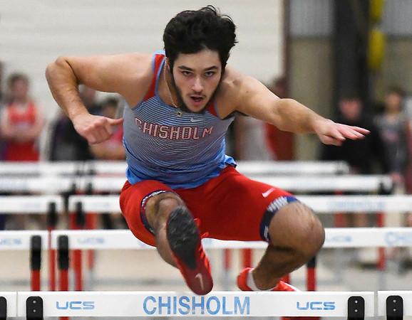 Chisholm's Garrett Eagen runs the 55-meter hurdles at the Chisholm Trail Expo Center Saturday February 2, 2018. (Billy Hefton / Enid News & Eagle)