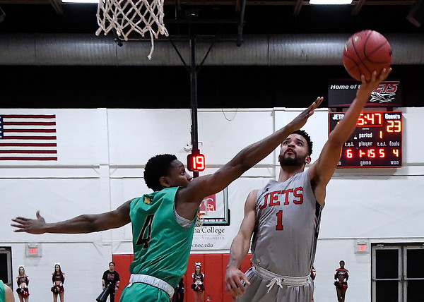 NOC Enid's Tony Hall puts up a shot against Western Oklahoma's Jeshon Jones Monday February 4, 2019 at the NOC Mabee Center. (Billy Hefton / Enid news & Eagle)