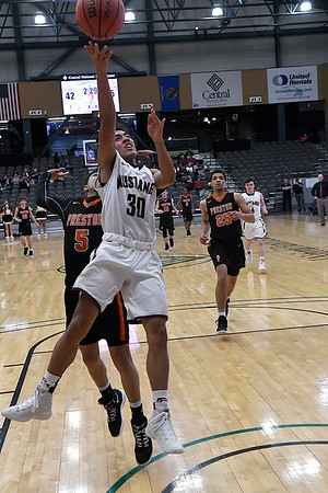 Pioneer's Kevin Noel beats Preston's K.J. Bagby down court for a layup during a Class 2A Area I elemination game Thursday February 28, 2019 at the Central National Bank Center. (Billy Hefton / Enid News & Eagle)